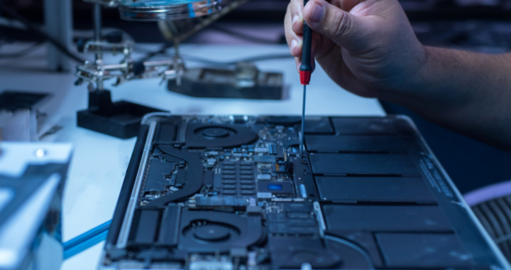 The engineer repairs the laptop and the motherboard. P