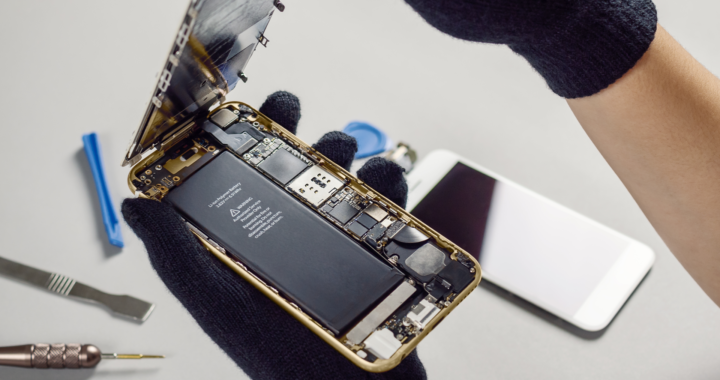 Technician or engineer opening broken smartphone for repair or replace new part on desk